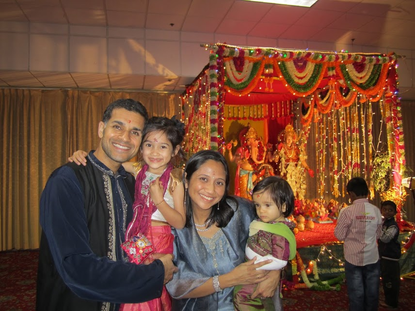 "Our family at the temple for Diwali, the festival of lights. Teaching the kids about the shared lessons of ""good over evil"" embraced by both their parent's religions. (Photo courtesy of Regina Manzana-Sawhney)"