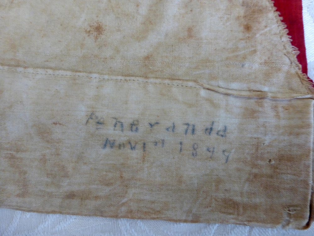 "Close-up of handwritten name ""Peñaranda"" with date ""Nov 1st 1899."" (Photo by I. Ver)"