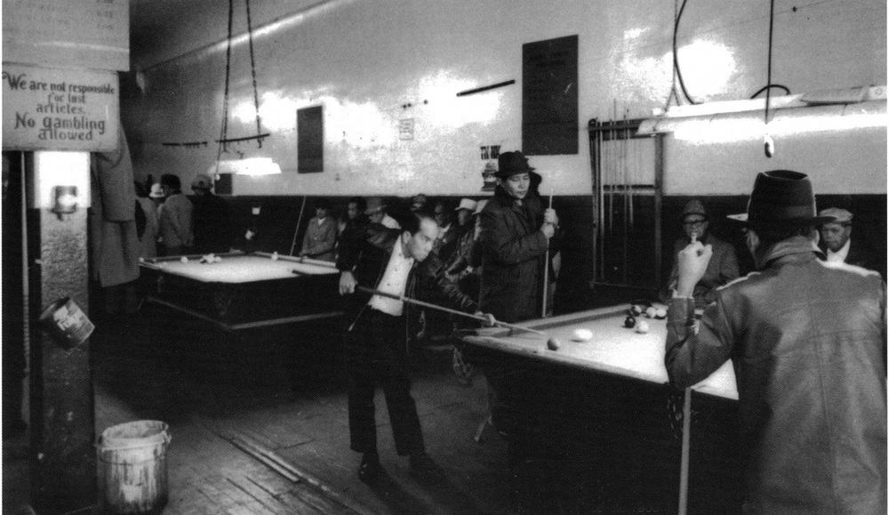Manongs playing billiards at the I-Hotel (Source: Filipinas Magazine, October 1997)