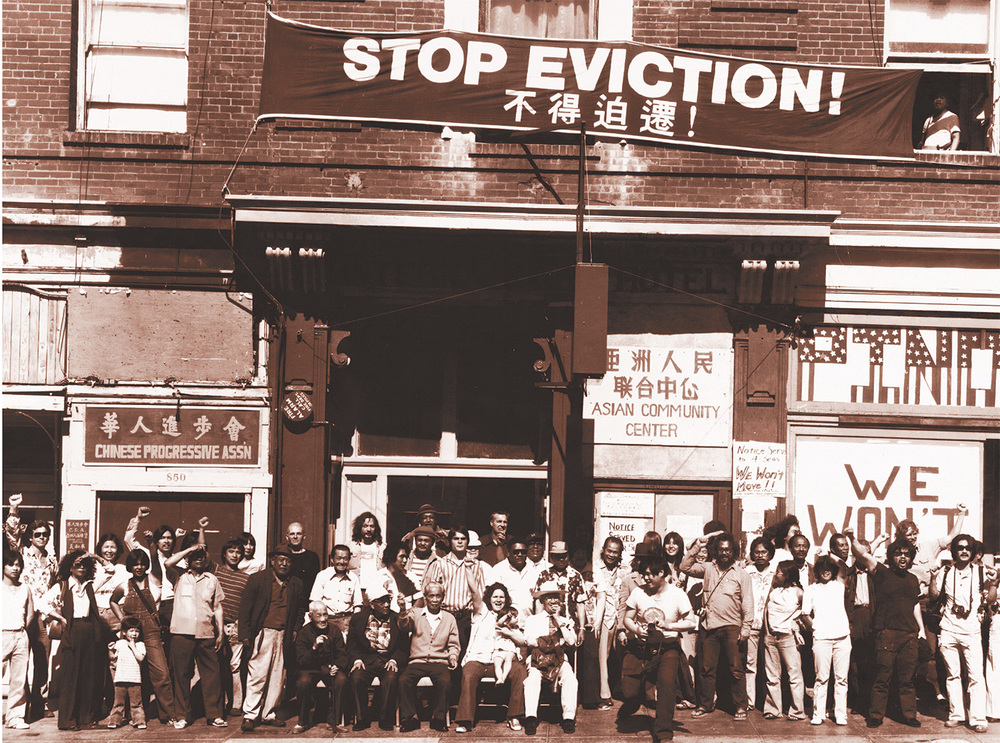 Residents and supporters line-up in front of the I-Hotel to prevent its shutdown in 1977 (Photo by Crystal Huie. Source: Manilatown Heritage Foundation/Filipinas Magazine, October, 2002)