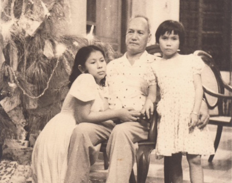 Mariano F. Manguerra, Sr. and his daughters (Photo courtesy of Cecilia Manguerra Brainard)
