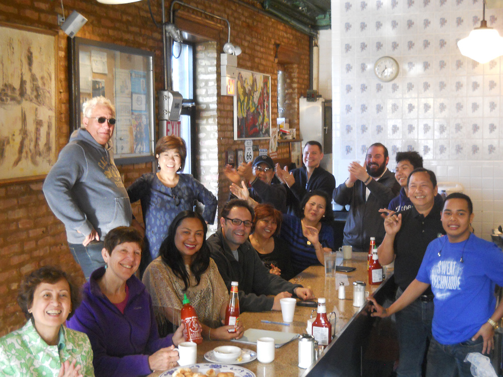 Mike and Lucie Grajewski (standing) lord over their kingdom of Filipino breakfast at Uncle Mike's Place in Chicago. (Photo by Ivan Kevin R. Castro)