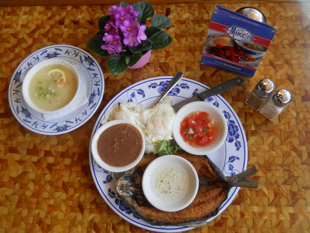 The milkfish breakfast, served with two eggs any style, garlic fried rice, and a bowl of fresh Chicago  lugaw  (rice porridge), which is in the upper left. (Styling by Joan Vande Kieft. Photo by Ivan Kevin R. Castro)