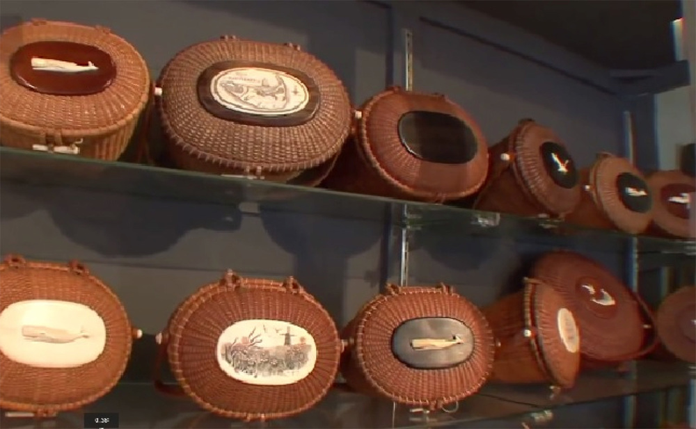 "A selection of authentic and ""in-the-style-of-Jose Reyes"" baskets at a Nantucket Antiques store. The look is not patented, but Reyes and other basket makers sign or apply labels on their creations. (Photo is a YouTube screen grab from Sylvia Antiques website)"