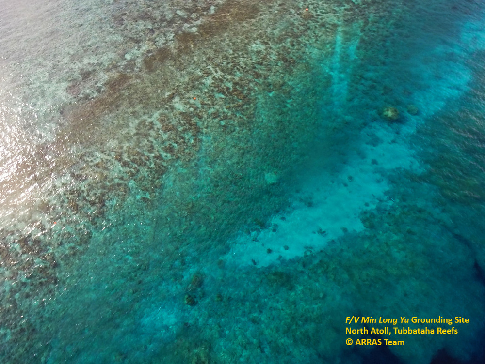 Grounding scar of F/V Min Long Yu, seen from the air. The prominent white patch has been nicknamed the 'Highway of Death' and is almost devoid of corals. (Photo by ARRAS Team)