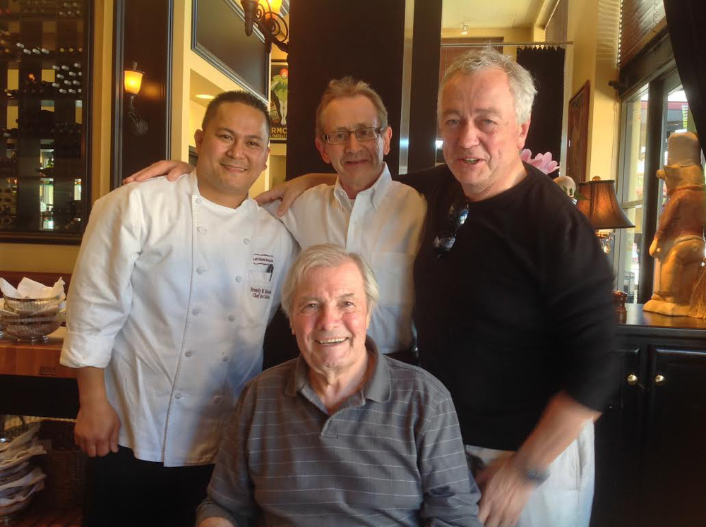 Brendy Monsada, left, with Master Chefs from France, Chef Joël Guillon, Chef Roland Passot and Chef Jacques Pepin (foreground center). Chef Brendy orchestrated Jacques Pepin's 75th birthday at Left Bank Menlo Park. (Photo courtesy of Brendy Monsada)