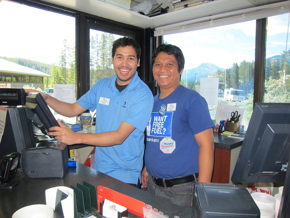 Oscar San Pedro (right) and Mark Harder run the gasoline station at Lake Louise, Alberta, Canada. (Photo by Mona Lisa Yuchengco)