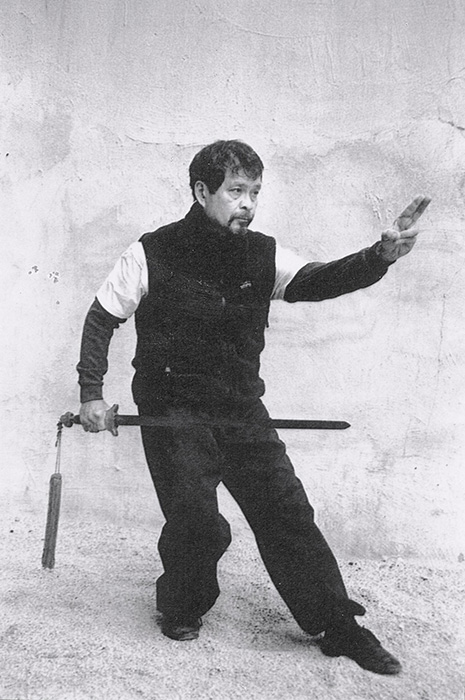 "Rene J. Navarro doing a Sword form of Yang Family Tai chi chuan, called ""Shoot the Goose,"" (Source: yang-sheng.com)"