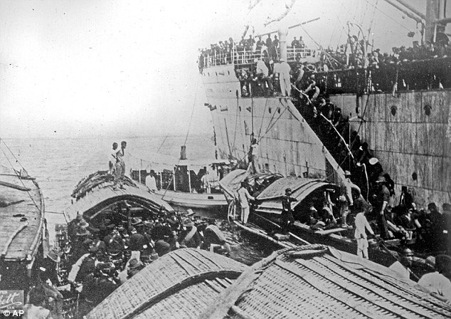 American soldiers were disembarking from a ship onto smaller boats near Cavite, Philippines, were likely taken by San Francisco Examiner special war correspondent Douglas White (Source: Georgia Newsday)