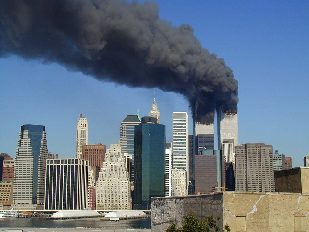 The World Trade Center, after it was struck by terrorists on September 11, 2001 (Photo by Michael Foran/Wikipedia/Creative Commons license)