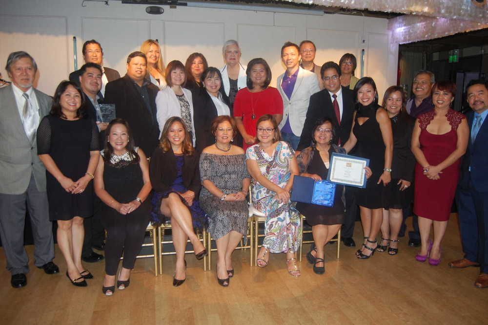 "Organizers, judges and winners of the Philippine American Press Club's 2014 Plaridel Awards. Positively Filipino publisher Mona Lisa Yuchengco (seated, left) accepted the awards for its writers. Writer Lisa Suguitan Melnick (top row, right) won 2 honorable mentions for her stories, ""Just Because"" and ""Celestino's Crusades."" (Photo by Raymond Virata)"