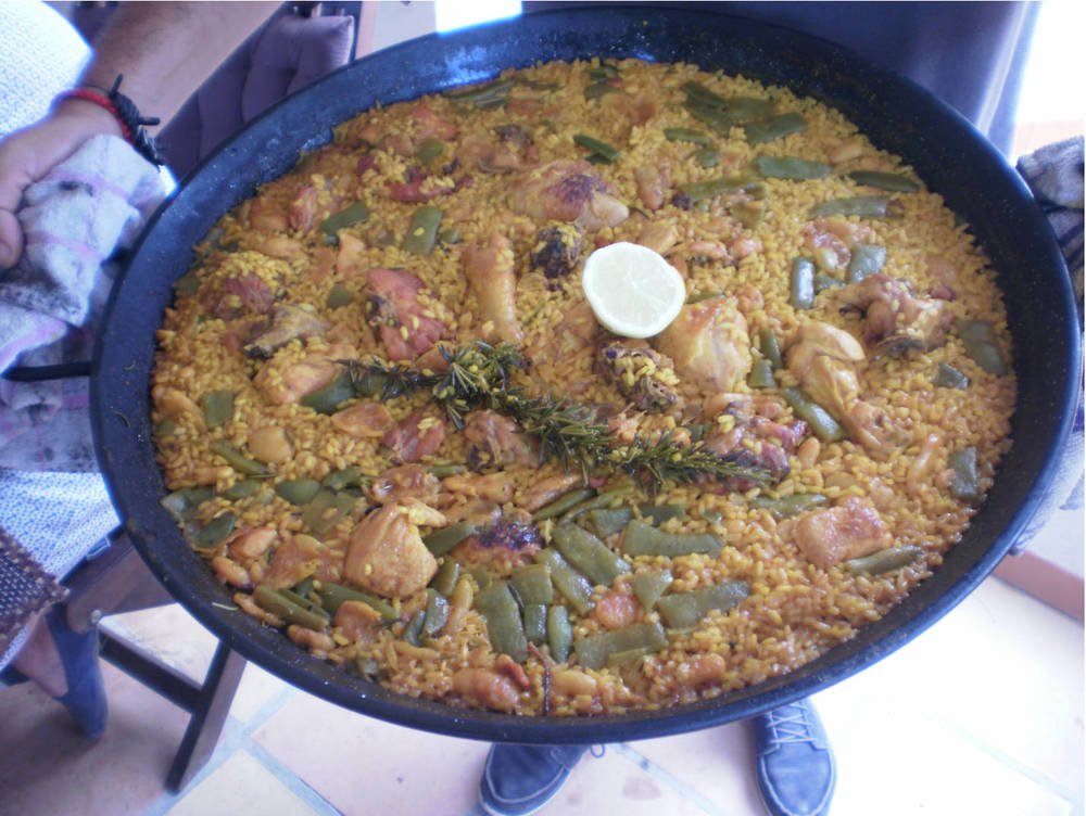 Paella valenciana is the mother of all paellas and the most revered dish in Valencia. (Photo by Rey de la Cruz)