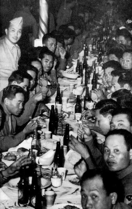 The 1st Regiment mess hall served Filipino food; photo shows a Company B party and dance. (Source: National Archives)