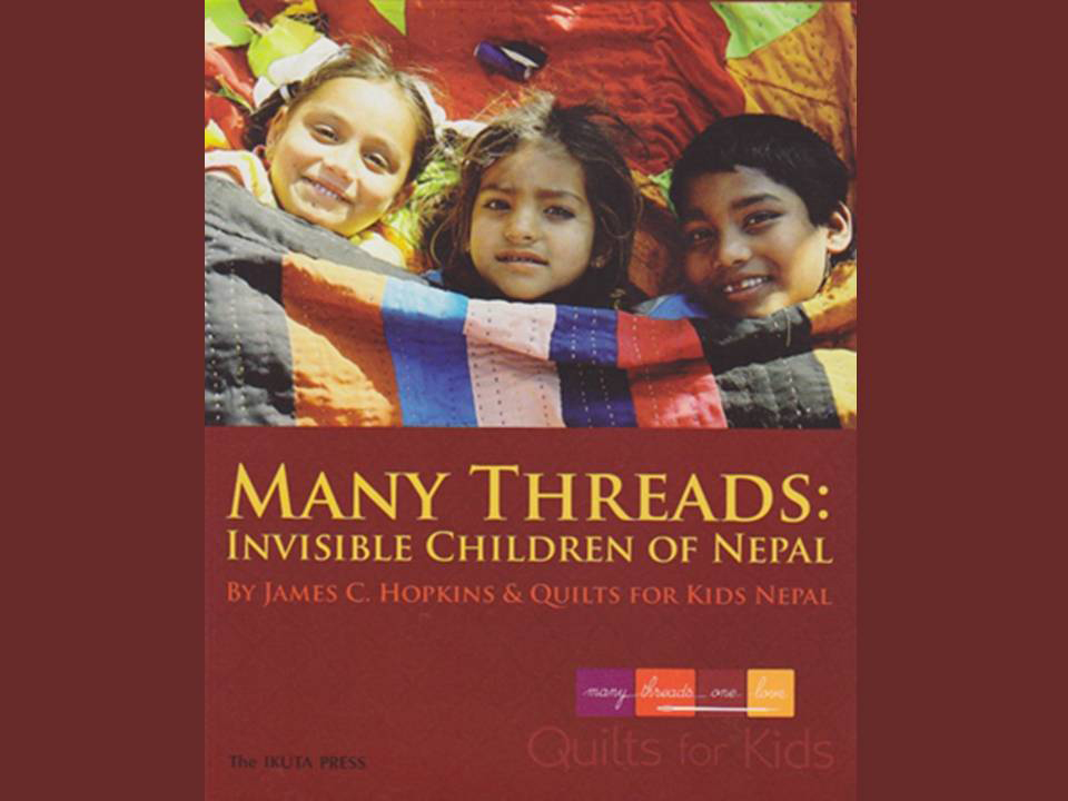 "Cover of ""Many Threads: Invisible Children of Nepal"", a life story picture and verse format, of  the quilt-makers community of beggars. The author, James C. Hopkins, is the founder and organizer of the social microfinancing organization, funded entirely from the sales of quilts."