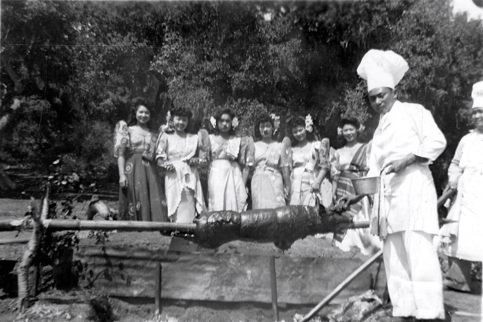The Filipino cooks roasted the pig in the traditional way. Pacita Todtod is second from the left, Helen Ragsac is third. (Helen Ragsac Sanchez collection).