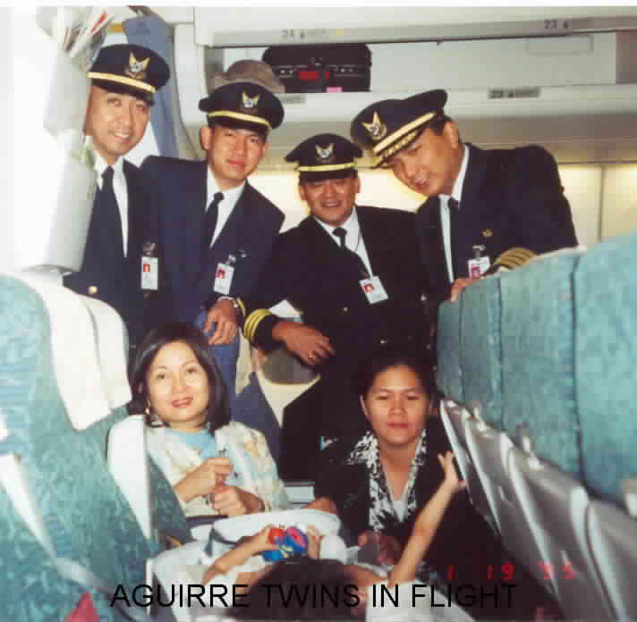 The Aguirre twins in transit to the U.S. for their operation. With the author (left seated), their mother Arlene, and the Philippine Airlines flight crew (Photo courtesy of Maria Carmen Sarmiento)