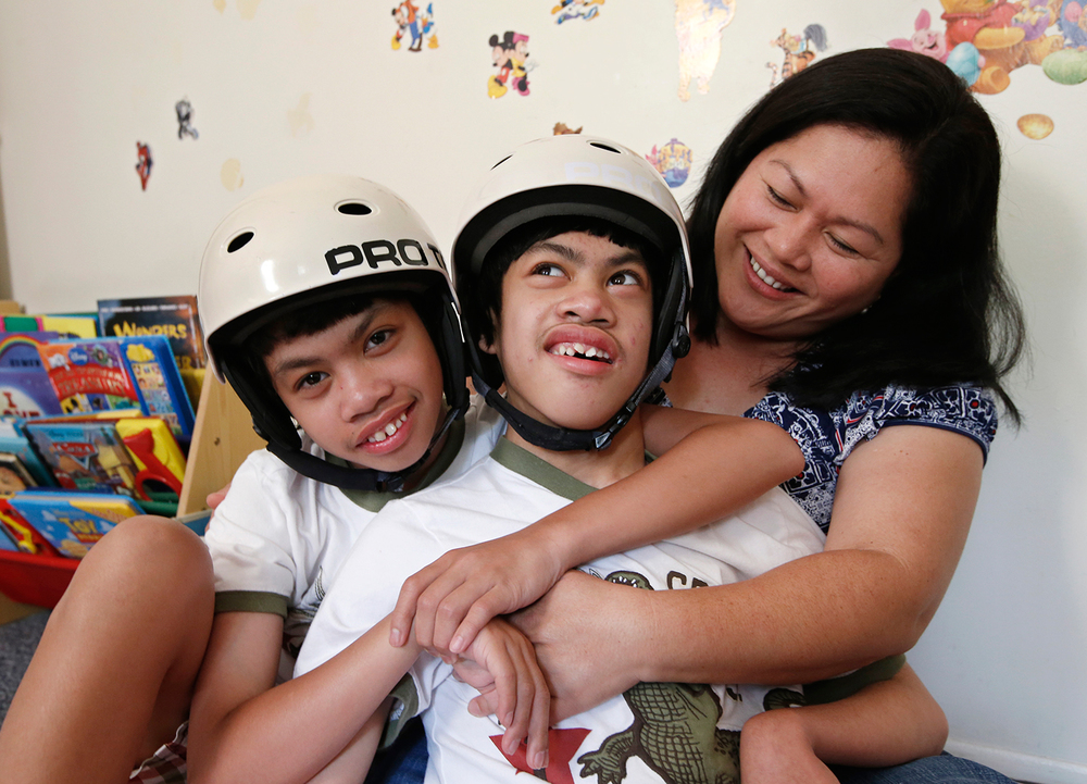 The Aguirre twins today. With mother Arlene (Photo by Kathy Willens/AP)