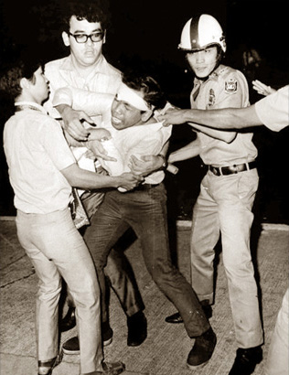 UP Student Council president Jerry Barican battling policemen at a rally: All those airy dreams burned out with the Battle of Mendiola of Jan. 30-31, 1970 as the twin scourge of  Maoism and Marcosian dictatorship swept across Diliman and all but devoured what passed for Philippine democracy as well. (source: philstar.com