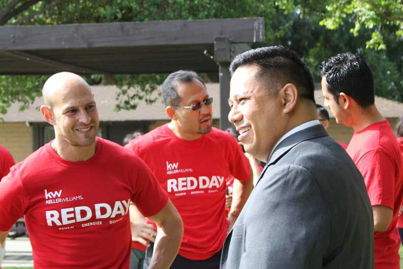 "Mayor Pulido at KellerWilliams' ""Red Day,"" an annual day of service of the realty company (Photo courtesy of the City of Cerritos)"