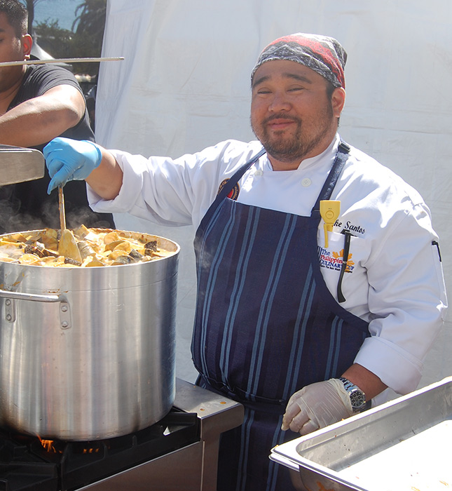 Chef Michael Santos prepares Kare-Kare for Savor Filipino attendees (Photo by Raymond Virata)
