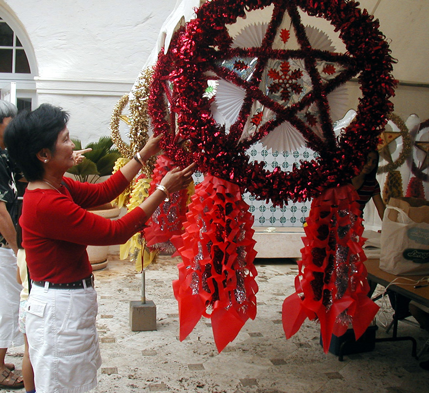 Estrella Seese setting up a parol (Photo courtesy of Filipino Association of University Women)