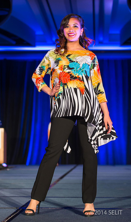 Multi-color leaf and zebra print boat neck handkerchief hem tunic top paired with black straight-legged pants (Photo by Selit Rapadas/UNIT ONE Photography Studio)