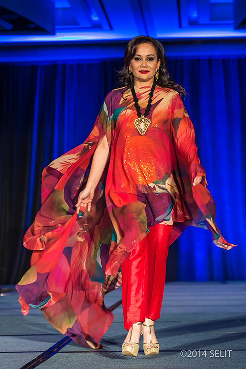 Multi-color floral print kaftan top and gold camisole paired with crimson straight-legged pants (Photo by Selit Rapadas/UNIT ONE Photography Studio)