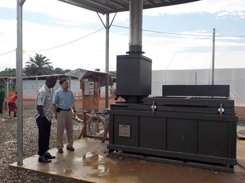 Jorge Emmanuel and Dr. Babacar Ndoye examining a UK incinerator at an Ebola Treatment Unit  under construction (Photo courtesy of Dr. Jorge Emmanuel)