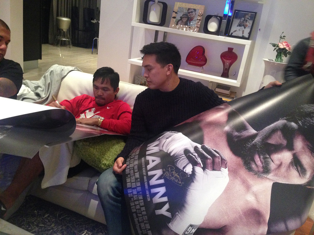 Pacquiao signing posters with Moore (Photo courtesy of Ryan Moore)