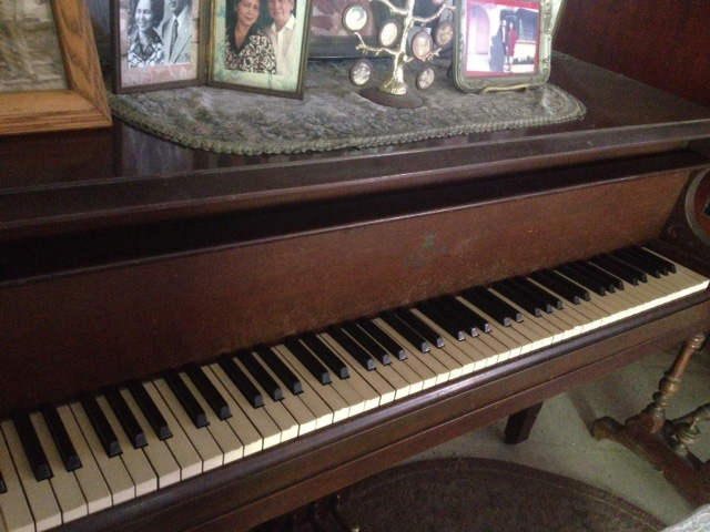 Leonor Rivera's piano with ivory keys where her delicate fingers played sweet music. (Photos by Elizabeth Ann Quirino with thanks to the family of the late Dr. Carlos R. Kipping Jr., Camiling, Tarlac)