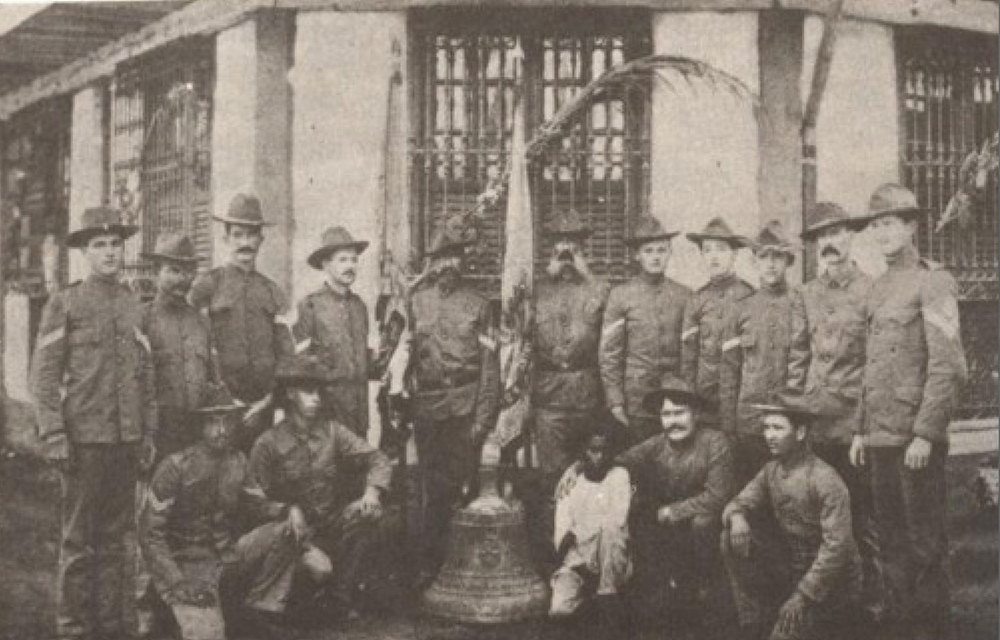 American soldiers with one of the captured Balangiga Bells, Samar 1902 (Photo courtesy of The Committee for the Return of the Bells)