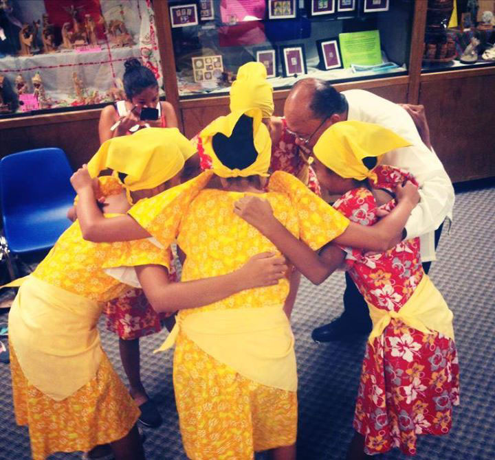 Alforque in a pre-performance huddle with young Sinag-tala dancers (Photo courtesy of Sonny Alforque)