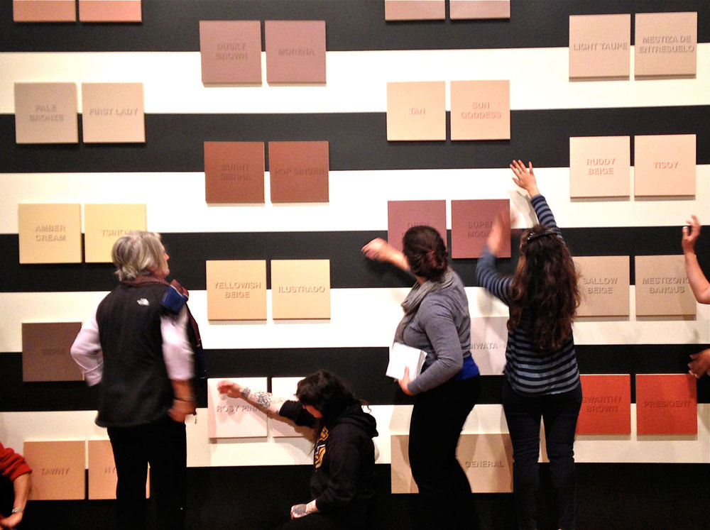 Exhibition viewers try to match their skin colors to the Kayumanggi shades (Photo by © France Viana)