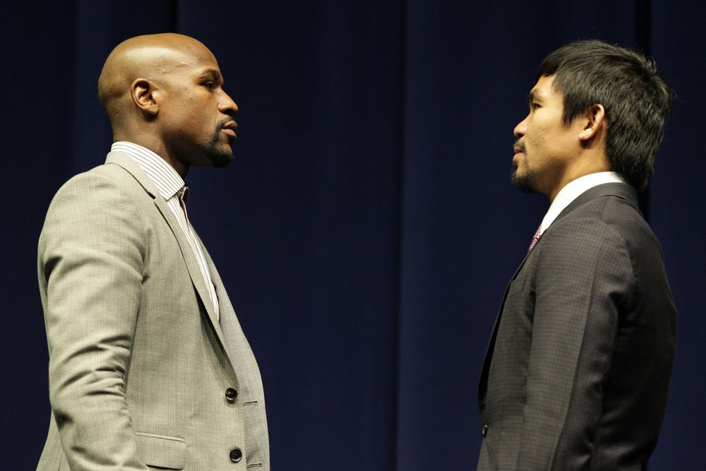 Floyd Mayweather, Jr. sizes up Manny Pacquiao during the press conference announcing the fight (Source: HBO)