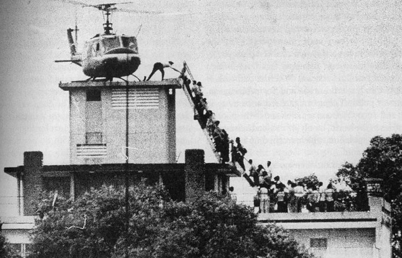 Forty years after the fall of Saigon, Ken Kashiwahara returned to the scene of the one of the most signature images from that historic day. The photo by Hubert van Es shows panicked South Vietnamese citizens hurrying up a ladder to grab one of the last seats aboard a US helicopter that could take them out of South Vietnam before the communist takeover.