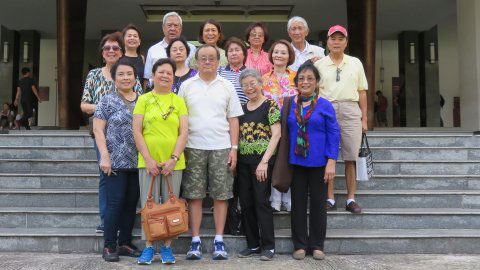 Outside the Presidential Palace. Ken Kashiwahara (front, middle) and Thuan Trinh (front row right) (Photo courtesy of Ken Kashiwahara)