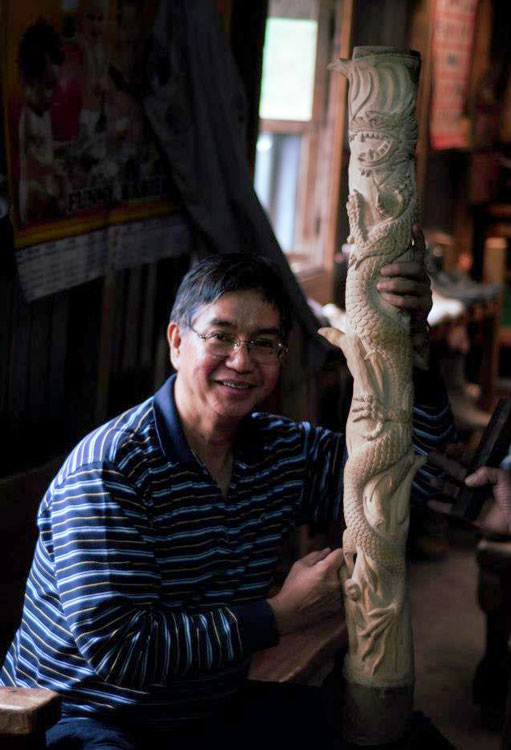 Edgardo Manda, the president of the foundation showcases one of the bamboo carvings handcrafted by an Ifugao carver. (Photo courtesy of the Philippine Bamboo Foundation, Inc.)
