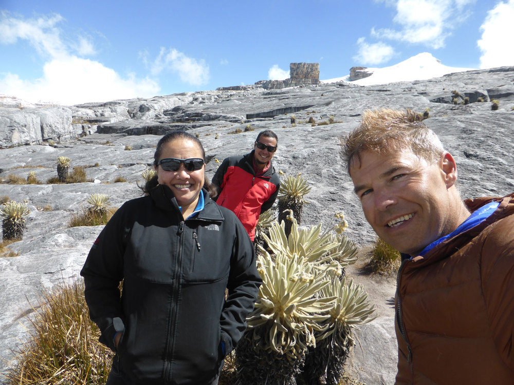 After a four-hour trek to reach 15,092 feet, the author, Louie, and Peter pose at the feet of Pan de Azúcar and El Púlpito del Diablo, two distinct geographical features of Sierra Nevada del Cocuy in Colombia. (Photo courtesy of Louie Hechanova)