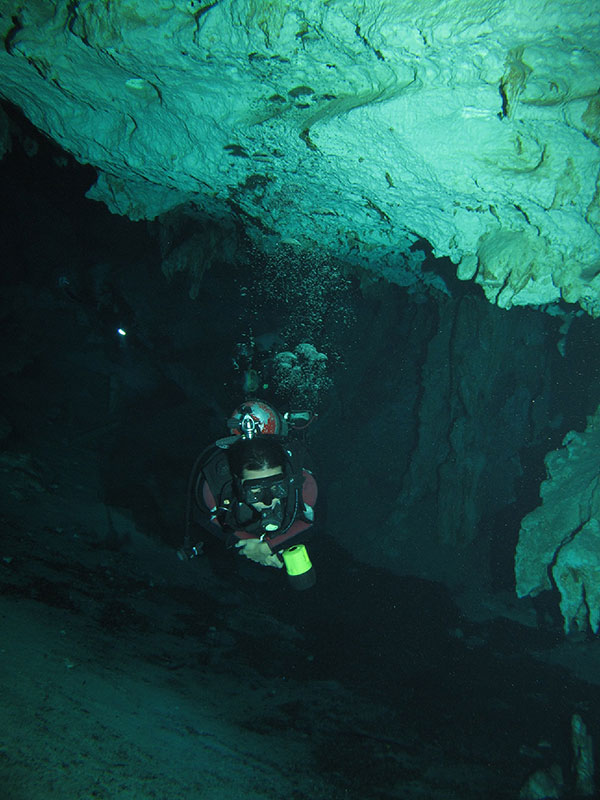 Besides trekking, cave diving is Louie's other favorite activity when traveling. Here he explores the caverns of a cenote in the Yucatán Peninsula of Mexico. (Photo courtesy of Louie Hechanova)