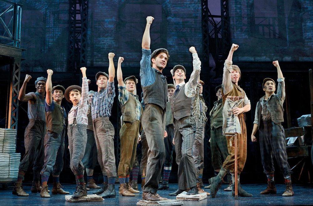 "Julian De Guzman (right) and the cast of ""Newsies"" (Source: Disney Theatrical Productions)"