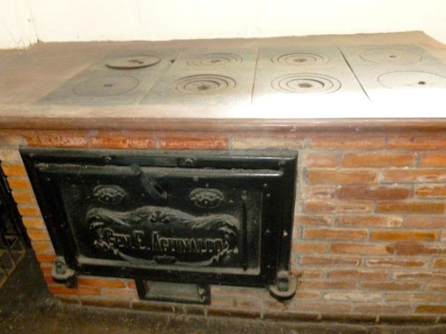 "The Aguinaldo stove had 8 large burners fueled by ""apa"" or rice hulls. (Photo by Elizabeth Ann Quirino)"