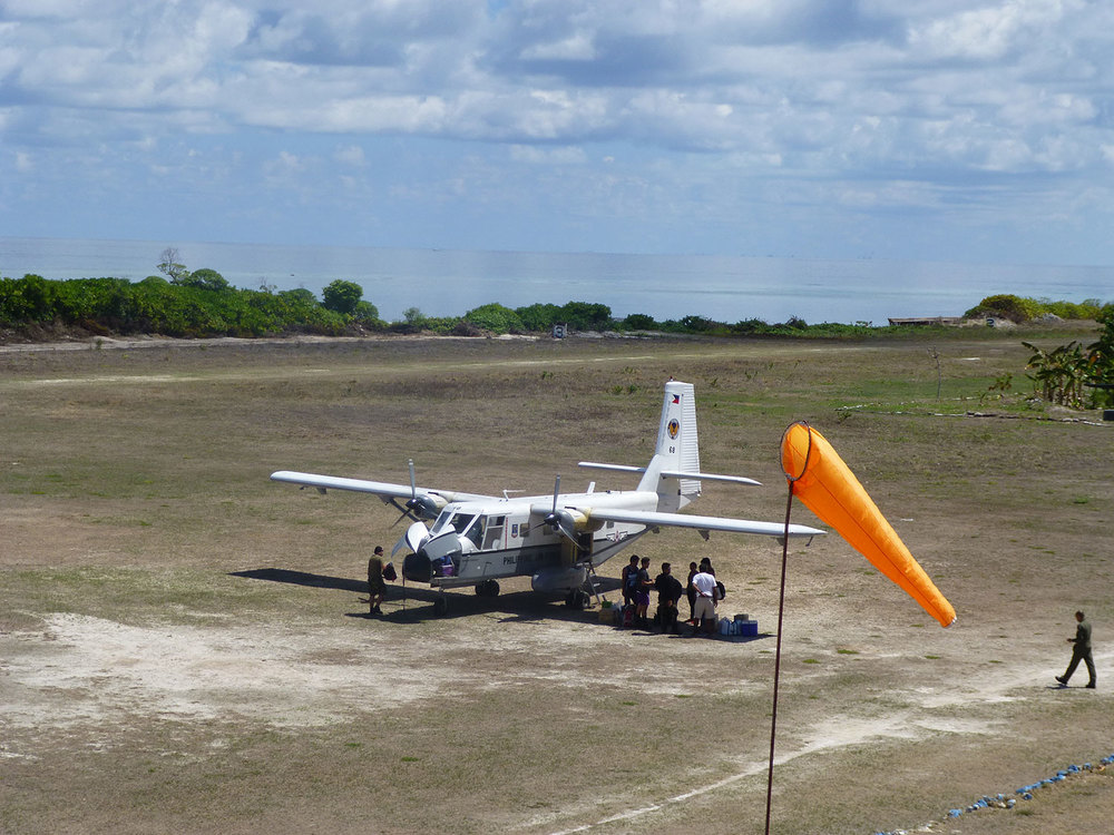 A Philippine Air Force Nomad plane lands on the airfield on Pag-Asa, bringing much-needed supplies. (Photo by Criselda Yabes)