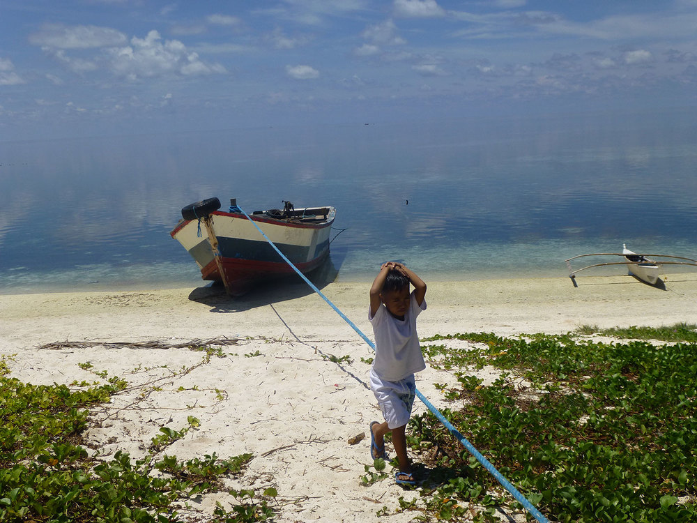 One of the children playing on the shore near the coast guard sub-station. (Photo by Criselda Yabes)