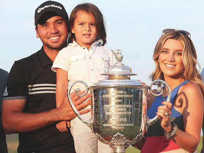 The Day family (Jason, son Dash, and wife Ellie) posing with the Wanamaker trophy of the PGA Championship (Source: Getty Images)