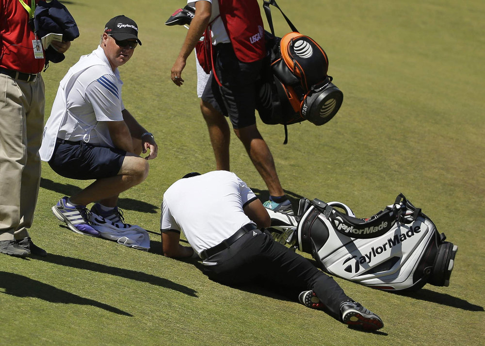 Caddie Colin Swatton looked after Day as he succumbed to vertigo at the U.S. Open earlier this year. (Source: Associated Press)