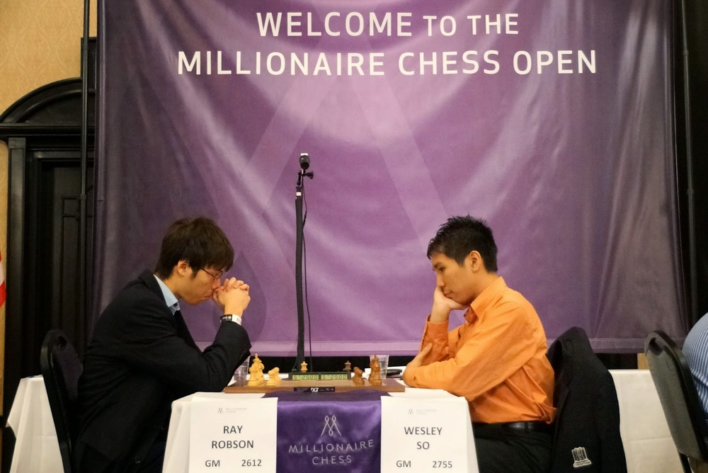 Wesley So (right) vs. GM Ray Robson at last year's Millionaire Chess Open in Las Vegas (Source: Chess Daily News/Photo by Susan Polgar)