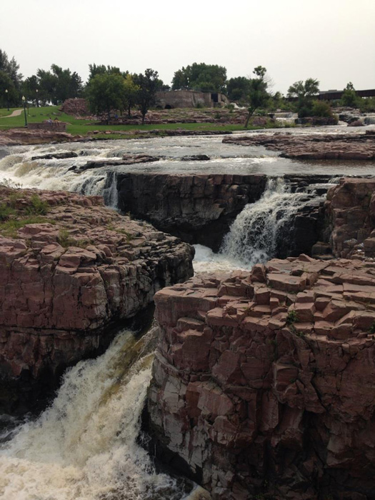 Sioux Falls, South Dakota is built around the natural waterfalls in its midst. A park has been created around this natural wonder so visitors can wander and wonder. (Photo by Irwin Ver)
