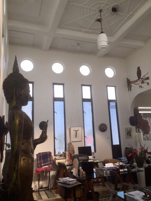 "Author's office in ""Daku Balay"" with original bas relief renderings lifted from local folk tales ""Owl and the Bat"" (right wall) and ""Spider and the Fly"" (ceiling) (Photo by Lilia V. Villanueva)"