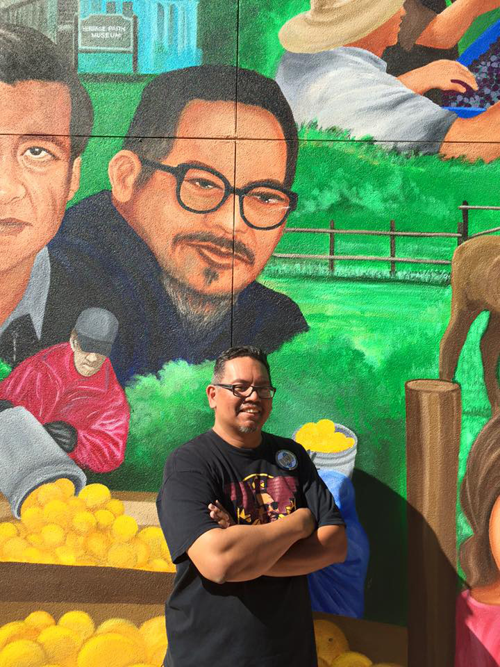 Johnny Itliong in front of Delano mural depicting his father, Larry Itliong (Photo courtesy of Johnny Itliong)