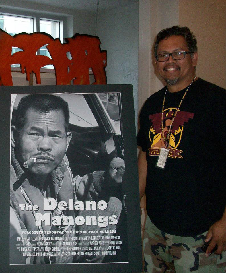 "Larry Itliong by poster of his father, Larry Itliong for ""Delano Manongs"" film (photo courtesy of Marissa Pulido Rebaya)"